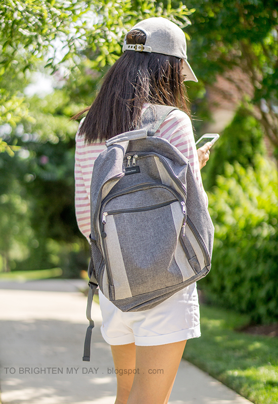 gray baseball cap, pink striped top, white shorts, gray canvas backpack