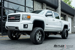 GMC Sierra with 24in Amani Forged Verato Wheels and Nitto Mud Grappler Tires with 8in Fabtech Lift 1