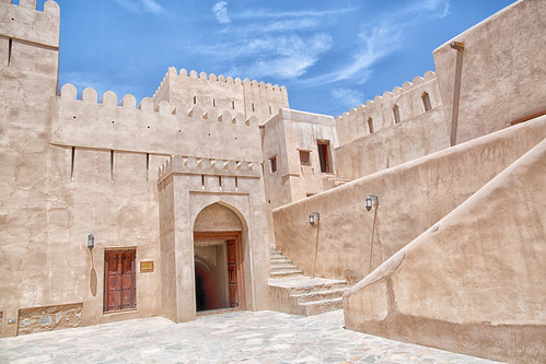 oman nizwa fort architecture historical walls stairs fortress military color photograph middleeast gulfstates outdoors touristdestination