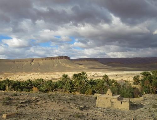morocco moroccan landscape atlas highatlas mahgreb mountain berber graveyard cemetery mausoleum palm desert view travel african africa scenic peak sky clouds easternmorocco pass building