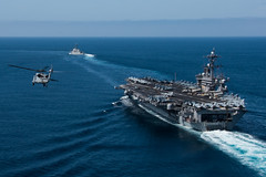Ships and aircraft from the Theodore Roosevelt Carrier Strike Group operate in the Pacific during a group sail exercise in May. (U.S. Navy/MC2 Paul L. Archer)