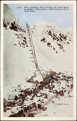 """""""Over Chilkoot Pass During the Gold Rush in Alaska.  Thousands of Gold Seekers Used this Trail."""" Postcard C121, H.H.T. Co., (1920s)."""