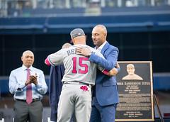 Derek Jeter receives a special Monument Park jacket from former teammate Carlos Beltran.