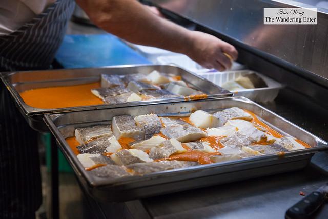 Cook preparing Pimientos asados con bacalao (roasted pimento peppers with bacalo)