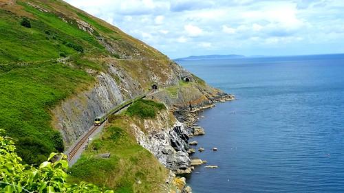 sakarip train railroad sea ireland bray wicklow coastline green cliffwalk water sky clouds
