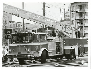 Firemen fighting fire in building Victoria St, Wellington