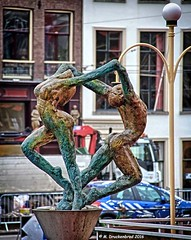 Dancing Statues on Rokin Street in Old Center Amsterdam