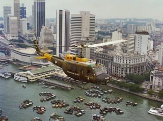 1977 RNZAF Iroquois NZ3806 over Clifford Pier, Singapore