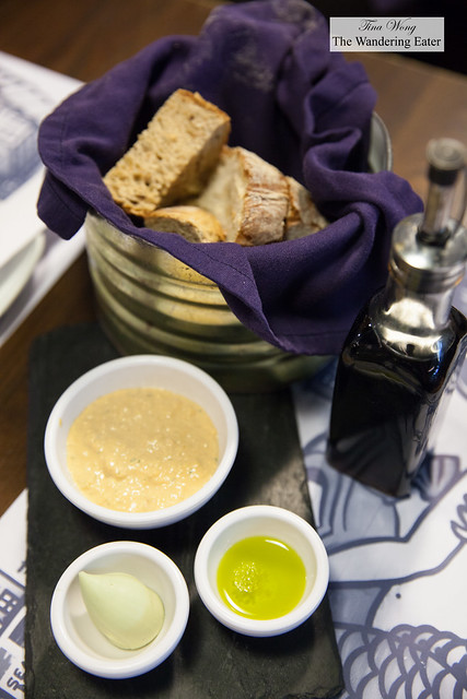 Bread basket served with crab butter, seaweed butter