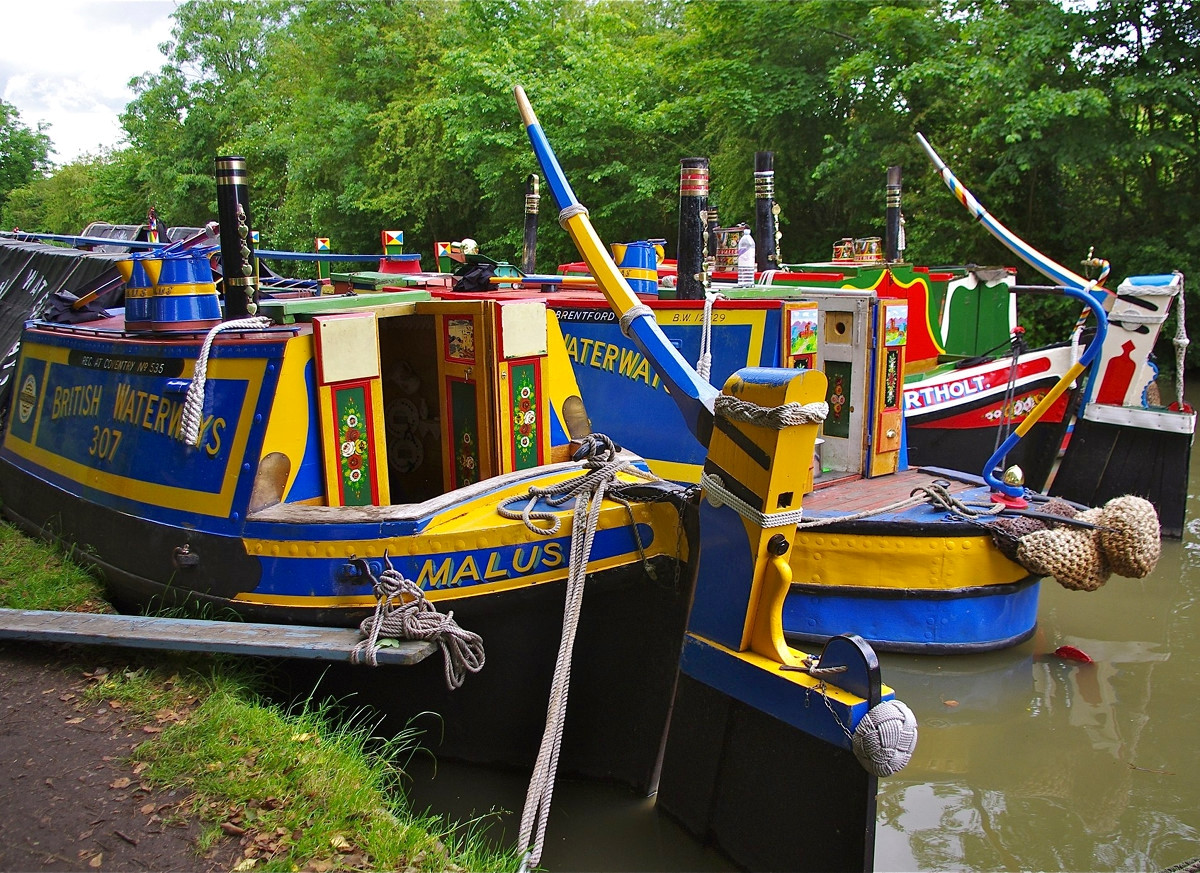 Brightly coloured historic narrowboats at Braunston, Northamptonshire. Credit David Merrett