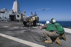 Sailors launch an unmanned aerial aircraft aboard USS San Diego