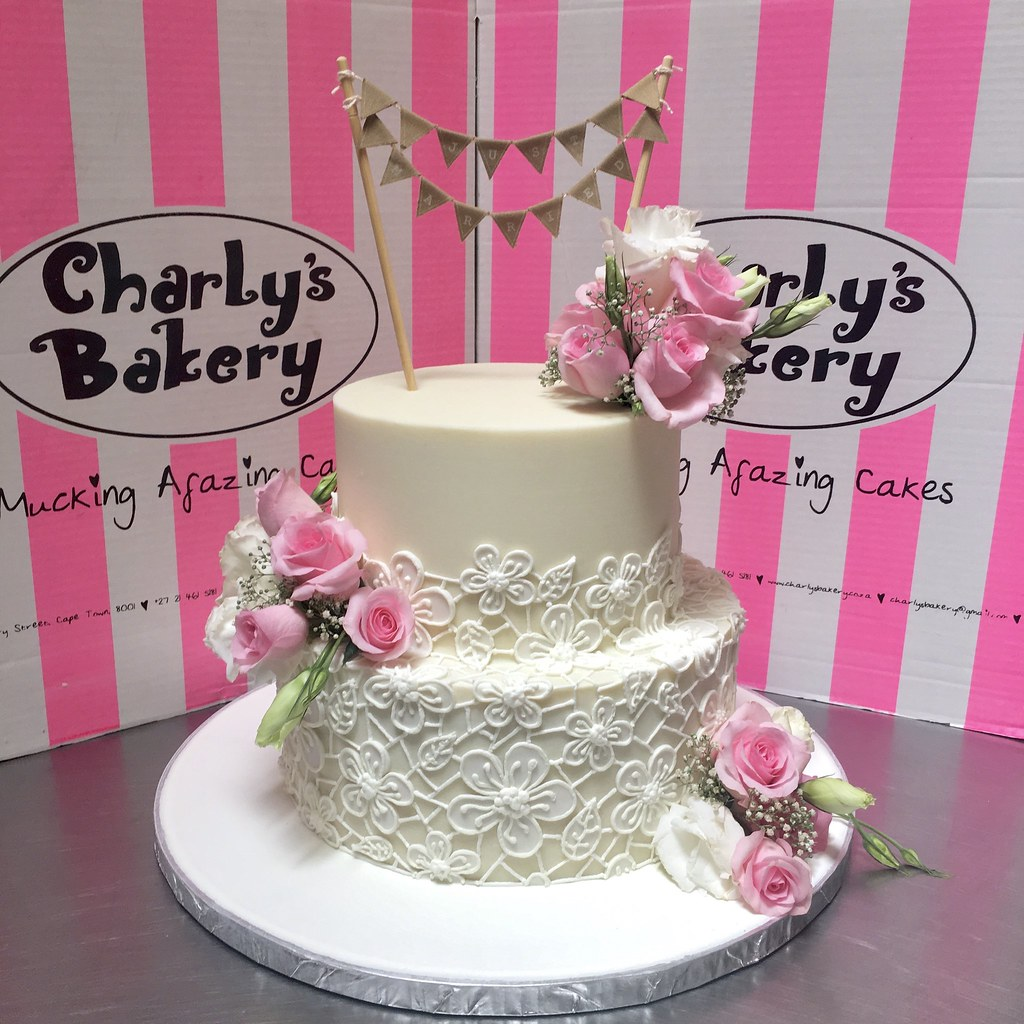 2-tier Wedding Cake iced in white chocolate ganache, decorated with ...