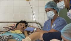Christine Booth, Project Hope volunteer, comforts a burn victim receiving medical care at Da Nang General Hospital during Pacific Partnership 2017 Da Nang, May 9. (U.S. Navy/MC2 Joshua Fulton)