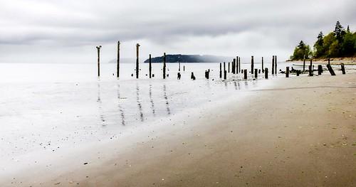 picnicpoint edmonds washington unitedstates us landscape beach shoreline pugetsound pilings longexposure stormclouds trinterphotos