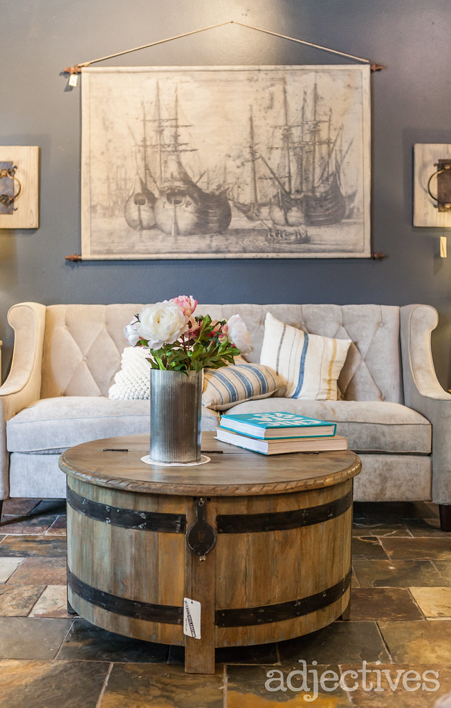 Rustic wood coffee table and living room home decor at Adjectives Winter Park