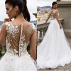 The back on this exotic wedding gown is amazing. Have xouture #weddingdresses like this made in a price range you can afford by requesting a #replicadress that is the same in style and appearance but is a fraction of the cost. Get pricing on any design yo