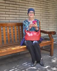 V, a bench, a big red bag, and a smart phone... #cancersucks👎 #ritzcarlton #beautifulday☀️ #portrait #portraitphotography #olympus #em10markii #20mm