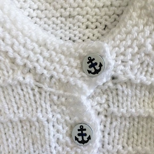 Just found this photo from a baby cardigan I knit last year for a friend's baby girl. Hope baby A is enjoying it. #anchors #buttons #babyknits #knittersofinstagram #knitstagram