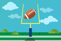 football flying through the goal post