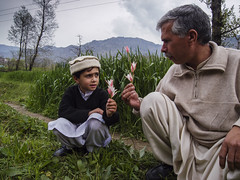Father and son with flowers Swat Valley 3705