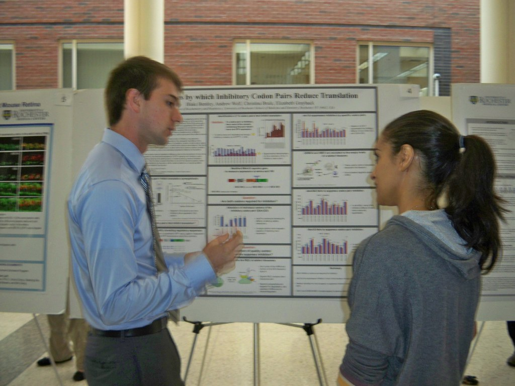 Blake Bentley discussing research on his poster