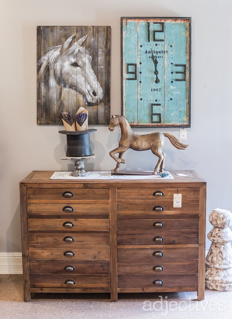 wood dresser and rustic clock with horse decor at Adjectives Winter Park