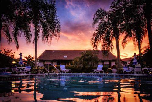 reflection sky sunset swimmingpool tropical water