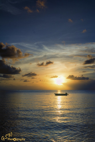nikon nikond7100 d7100 gswphotography landscape clouds sky land weather sunset water reflection silhouette extremesky antigua jollybeachresort beach sea swater waves horizon gold blue boat