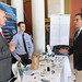 State Rep. John Fusco talks with Doug and Tyler Johnson, of Marion Manufacturing, during the annual Manufacturers Day at the Capitol.