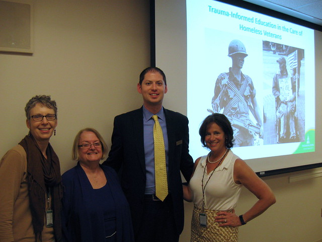 Marilyn Hughey (second from left) delivered the research presentation for her Doctor of Nursing Practice degree on her 70th birthday in April. Alongside Dr. Hughey are (left to right) Dr. Debra Berke of the College of Social and Behavioral Sciences; Dr. Aaron Sebach, chair of the DNP program; and Dr. Barbara Sartell of the College of Health Professions.