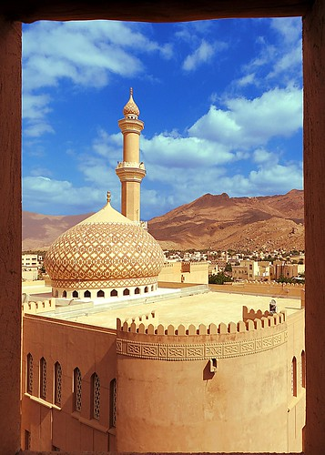 mosque fort nizwa oman frame mountain clouds crayons minaret