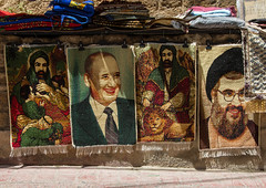 Sheikh Hassan Nasrallah and ali carpets for sale in the street, South Governorate, Tyre, Lebanon