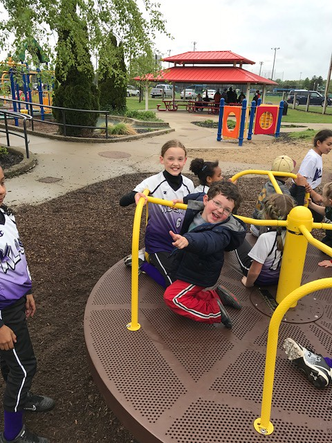 Owen Stanek and Breslyn Zache enjoying the merry-go-round