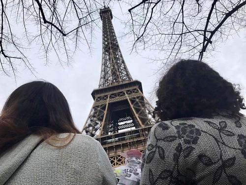 Emily Shlafmitz '18 majoring in English participating on spring 17 London English study group peeking at the Eiffel Tower