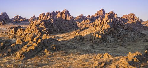 gobi desert mongolia scenery landscape rocks sunrise ikh gazriin chuluu rock formation flaming red fire