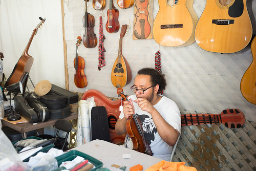 Instrument maker at Jazz Fest 2017. Photo by Ken Maldonado.