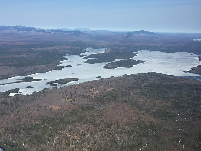 As of late April many larger Maine lakes are still locked in ice, but its receding fast.  Photo Credit: USFWS