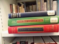 A Stack of Legal Books Including Serious Fraud Information