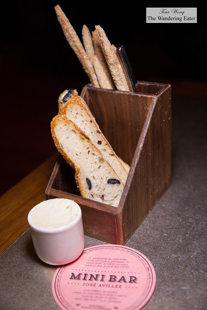 Slices of olive bread and bread sticks