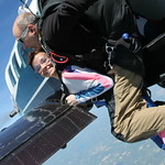 Tandem Skydiver Anna Exiting With Her Instructor Rick Sales