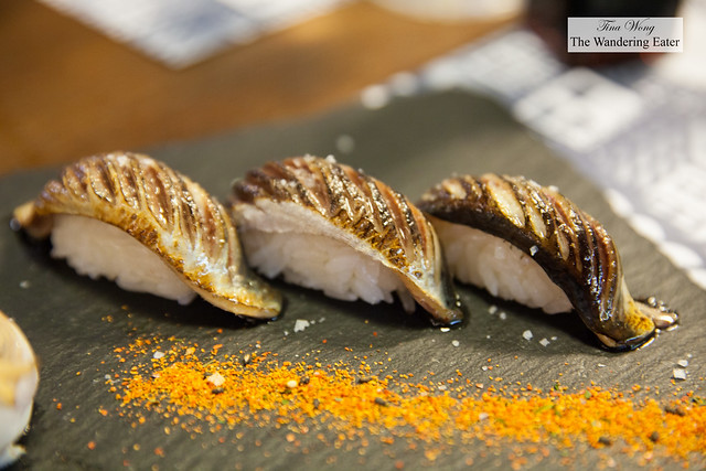 Blowtorched sardine nigiri with togarashi