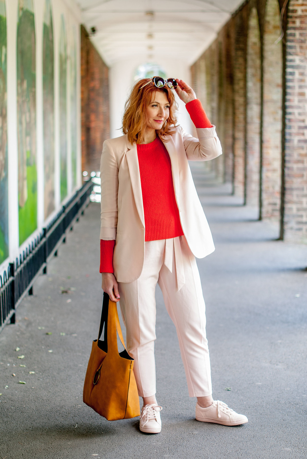 Bright spring/summer outfit: Blush pink trouser (pants) suit matching sneakers tomato orange red sweater yellow ochre suede hobo bag tortoiseshell sunglasses | Not Dressed As Lamb, over 40 style