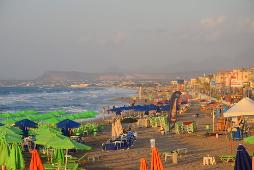 summer mood beach rethymno rethymnon sand parasols umbrellas hills mountains island sea waves water blue colours sunny haze cloudy landscape view nature travel holiday mediterranean crete kriti kreta greece greek