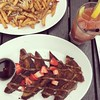Brunch done right. Brioche French toast with Nutella, maple syrup, and fresh strawberries, along with some Bloody Mary and truffle fries!