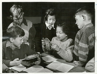At the George Street Normal School, Dunedin, small pupils work out a clock puzzle.