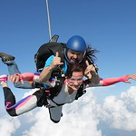 Tandem Skydiver Natasha In Freefall Rockin' It Out!