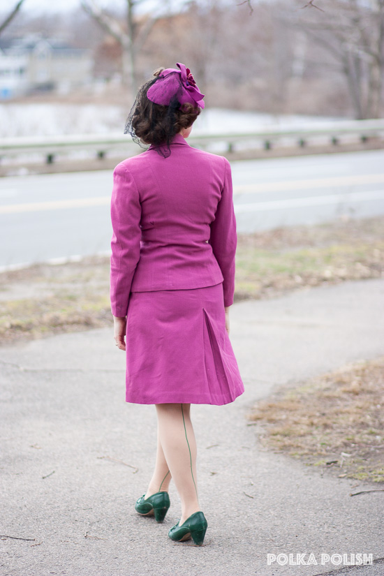 Pink 1940s suit and hat paired with green shoes What Katie Did retro seamed stockings in green