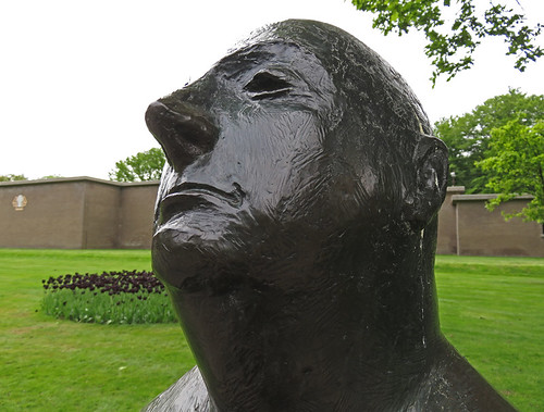 Statue of a somewhat self-satisfied man in Kroller Muller Sculpture Garden near Utrecht in Holland