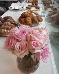 Roses and Croissants • 5.17.17 • #pinkroses #croissant #roses #croissants #chouxchouxbakery #everett #everettwa #flowersofinstagram #bakery #lateforwork #galaxys4