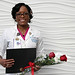 Cheryl Flowers, shown here receiving Bayhealth Medical Center's 2016 Healthcare Educator of the Year award in November, is graduating from Wilmington University with dual master's degrees five years after suffering a traumatic brain injury.
